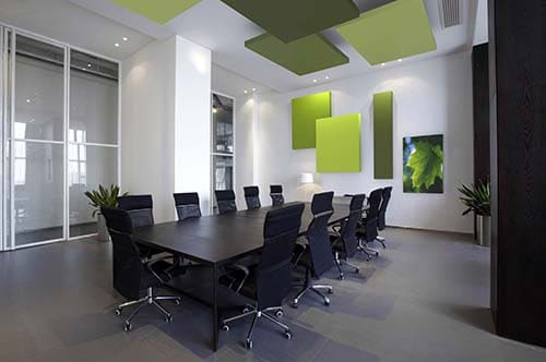 Meeting room with Arcolis acoustic frames hanging on the walls and ceiling